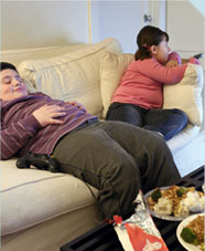 Fat children on a sofa